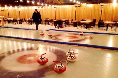 The owners of Kaiser Tiger have transformed the bar's beer garden into ice curling rinks.