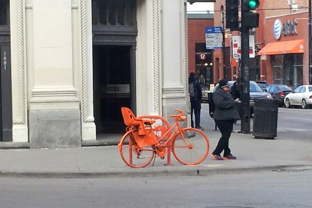 Bikes that are spray-painted orange have been locked to several bike racks for several days now.