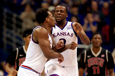 Cliff Alexander #2 and Wayne Selden Jr. #1 of the Kansas Jayhawks celebrate after scoring during the game against the UNLV Rebels at Allen Fieldhouse on January 4, 2015 in Lawrence, Kansas.