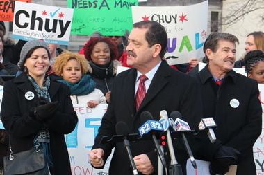 "Commissioner Jesus ""Chuy"" Garcia only rarely got excited on the campaign trail, as in this appearance with Cook County Clerk David Orr (r.) before the last debate, but he felt it Tuesday night."