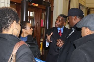 17th Ward aldermanic candidate David Moore speaks to a group of attendees after the Englewood Political Symposium on Feb. 7, 2015.