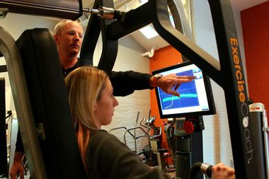 Founder and CEO of Exercise Coach Brian Cygan demonstrates a computerized machine in the Lincoln Park studio.