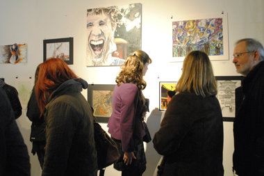 Guests check out the work of hundreds of art works submitted by high school students at the Illinois High School Art Exhibit. Students from around the state will converge on the Zhou B Art Center March 6 to showcase their art to win college scholarships.