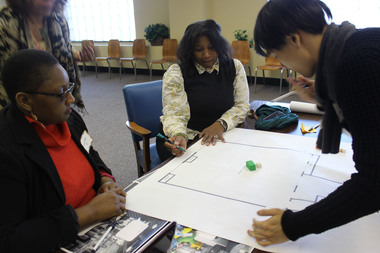 Five students doing an independent study with an architect/adjunct professor are helping to design a business innovation center that the Greater Englewood Community Development Corporation is pursuing. Students met with the business community Thursday, Feb. 12, 2015.