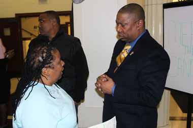 17th Ward aldermanic candidate James Dukes speaks to a woman after the Englewood Political Symposium on Feb. 7, 2015.