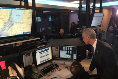 Mayor Rahm Emanuel speaks with a staff member at the Office of Emergency Management Thursday. As many as 7 inches of snow could fall in parts of the city, officials said.