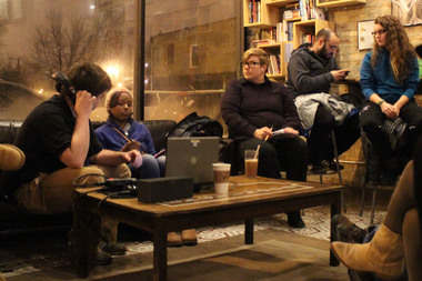 Community members gather for the Illinois Humanities Reporting Back series on Feb. 9, 2015 at Kusanya Cafe, 825 W. 69th St. Left, is journalist Bill Healy and next to him sits Chiquita Toby, a South Side resident.