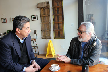Ald. Danny Solis talks with Jon Pounds, executive director of the Chicago Public Art Group at Bow Truss Coffee in February. The art collective will now work with the 25th Ward office to manage the Art in Public Places initiative.