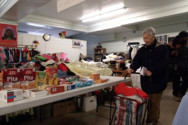 Uptown residents browse the American Indian Center's food pantry.