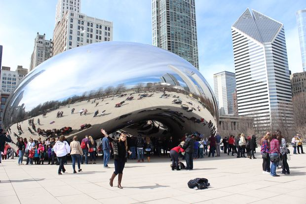 People take photos at the Bean, a popular attraction in Chicago. Chicago has long been the third-largest city in the nation, but Houston is poised to take that spot.
