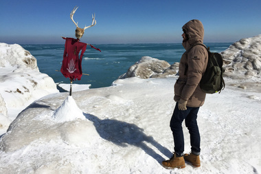 Jeremy Laurent, 26, visiting from France, takes a look at the severed deer head Monday in Rogers Park.