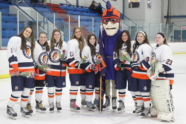 Grace Zarzecki (second from left) and some of her Latin School of Chicago hockey teammates. Zarzecki attends Whitney Young.