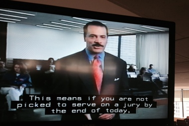 Lester Holt narrates a video for jurors at the Cook County Courthouse.