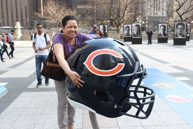 A Bears fan hugs the helmet of her favorite team in Pioneer Court.