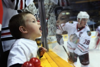 A young fan watches Jonathan Toews of the Chicago Blackhawks in warmups prior to the game against the Nashville Predators at the Bridgestone Arena on February 14, 2012 in Nashville, Tennessee.