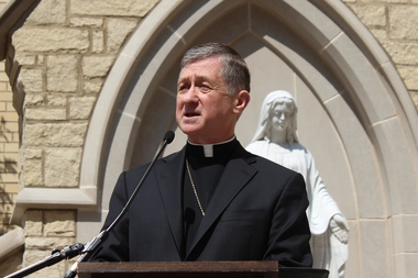 Archbishop Blase Cupich announced the death of Cardinal Francis George outside Holy Name Cathedral Friday.