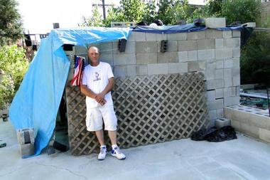 A homeless man built a cinderblock home on a failed condo development site.