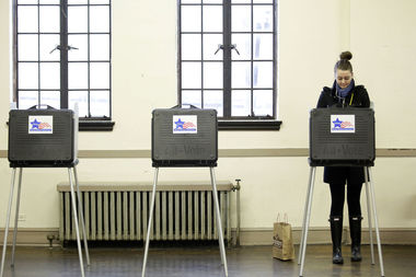 A Chicagoan casts her ballot on the 2015 mayoral election.