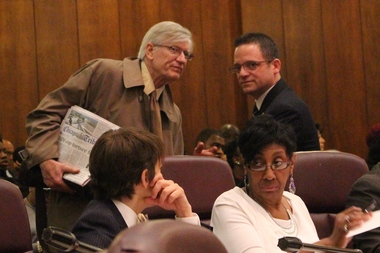 People's Law Office attorney G. Flint Taylor and Ald. Joe Moreno talk before Wednesday's City Council meeting.