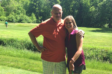 Kevin O'Brien, director of the FDNY 9-11 Memorial Golf Outing, stands beside Laurie Johnson, daughter of the late Chicago Fire Dept. Capt. Herbert Johnson of Morgan Park. The Herbie Johnson Golf Classic is expected to draw upward of 1,000 golfers on June 29.