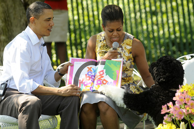 Barack and Michelle Obama read books to a group of kids at the White House on Easter 2011.