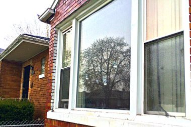 Bullet holes can be seen in the window of the residence where a woman died and two men were injured after sustaining gunshot wounds while leaving a party around 11 p.m. in the Roseland neighborhood, according to police.