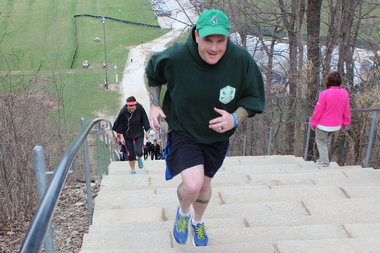 Steve Coyne often works out at Swallow Cliff in Palos Park. He has competed in dozens of charity stair climbs, often in his full Chicago Police officer's uniform.