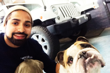 Victor Jaime and his dog George, who escaped a tow truck March 29.