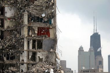 Crews demolish the last of the former Cabrini-Green housing project high-rises.