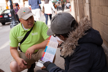 Chicago Loop Alliance Street Team Ambassador Edmund Garcia speaks with a homeless man Downtown.