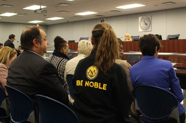 A Noble Academy supporter looks on as Principal Pablo Sierra addresses the CPS hearing.
