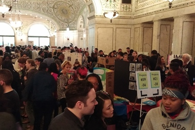 More than 300 high school students and their teachers crowded the Chicago cultural center Tuesday to show off posters detailing community projects they drew up.