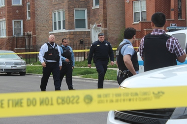 Two men were killed and a woman was wounded in a shooting Friday evening, police said.