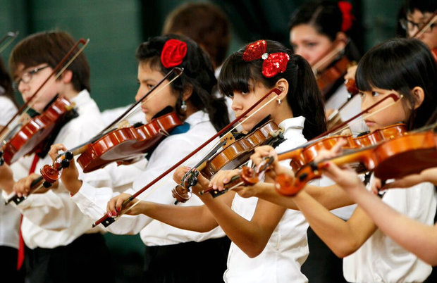 More than 300 young string musicians perform at Benito Juarez Community Academy.