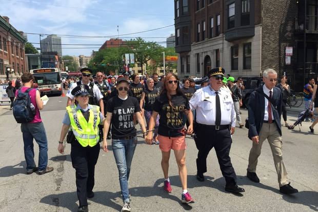 Protesters who staged a #BlackLivesMatter die-in during the Pride Parade are taken from Addison and Halsted in handcuffs to the Town Hall police district, 850 W. Addison St. just before 2 p.m. Sunday.