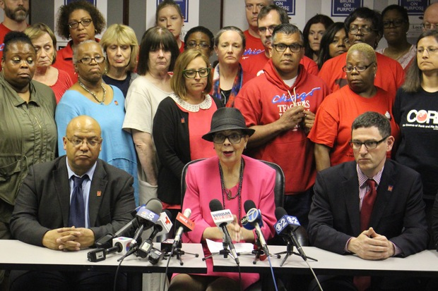 Chicago Teachers Union President Karen Lewis (center) and Vice President Jesse Shakey (right) hammered out a tentative deal with CPS officials Monday.