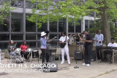 Dyett High School's senior rock band D13 plays a Decision Day Jam outside the school last month.