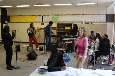 Dyett High School teacher Amy Silverman looks in on D13 during the students' band practice.