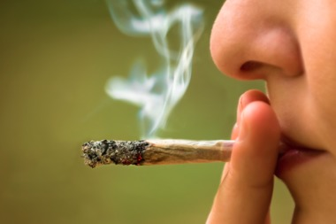 Chicago has decriminalized possession of marijuana, but that doesn't extend to open pot smoking.