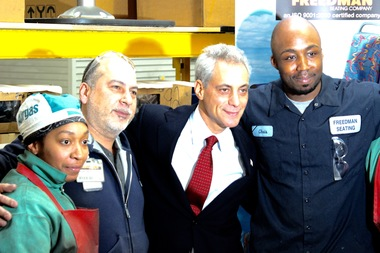 Mayor Rahm Emanuel with manufacturing workers at a West Side factory for making CTA bus seats.