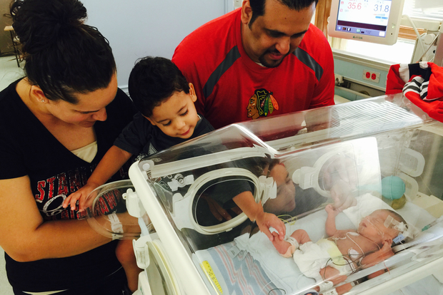 Lenis, Elijah, Roberto and DiMaggio Ramos look at Jonathan, the newest member of their family. Jonathan is partly named for Blackhawks captain Jonathan Toews. DiMaggio, Elijah and Jonathan were all born in years the Blackhawks won the Stanley Cup.