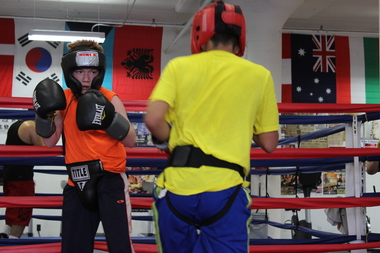 Young boxers spar at Sam Colonna's Brighton Park gym.