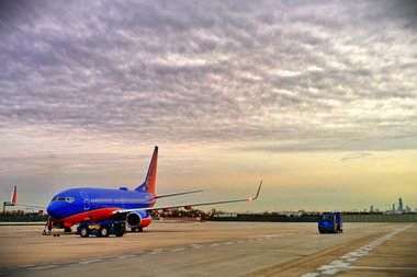 A Southwest Airlines place at Midway International Airport during sunrise