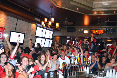 Fans celebrate the Chicago Blackhawks Stanley Cup win at WestEnd, 1326 W. Madison St., in 2013.