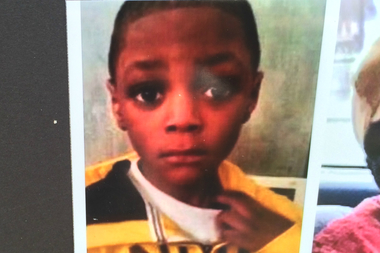 The photo of Amari Brown, 7, was hanging on the fence where he was shot and killed and a 26-year-old woman was wounded in a Humboldt Park shooting Saturday night, police said.