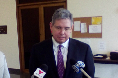 Attorney Patrick Keating responds to reporters' questions about a class action lawsuit targeting the city's red light camera program outside a courtroom in Daley Center Thursday.