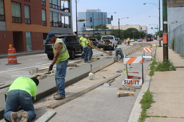 Workers are making progress on barrier-protected bike lanes along Clybourn Avenue in Old Town.
