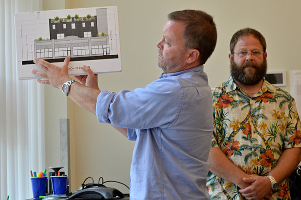 Developer Scott Whalen shows a full house some plans for the proposed brew pub at 1221 W. Devon Ave., with owner Alex Drayer in the background.