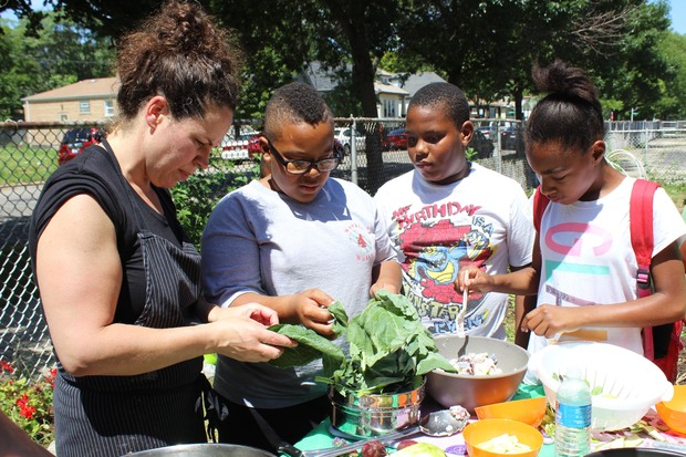 Stephanie Izard cooks with Englewood children on July 29, 2015.