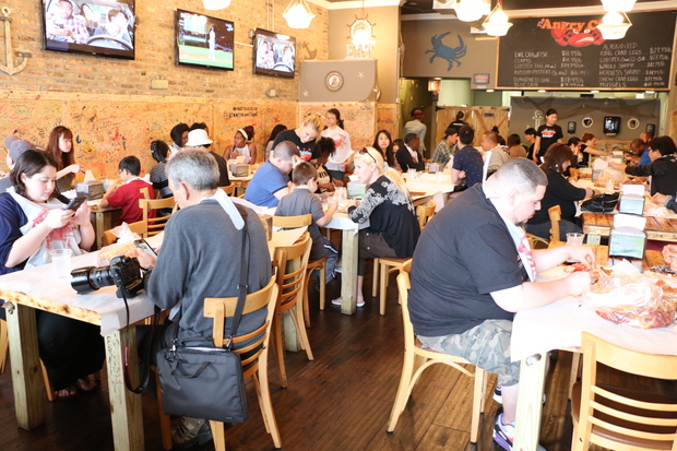 The Angry Crab, which opened in West Rogers Park in February, draws long lines of customers.
